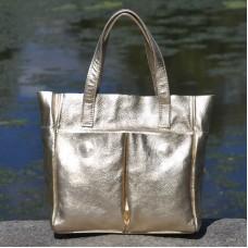 Женская кожаная сумка с карманами золотая